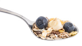 Muesli With Blueberries And Banana On A Spoon Stock Photos