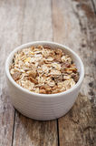 Muesli on wooden background Royalty Free Stock Photography