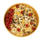 Muesli in wooden bowl and red currant isolated on Stock Image