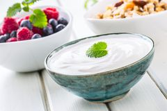 Muesli yoghurt and berries. Healthy breakfast with yogurt granola and fresh fruit.  stock photos