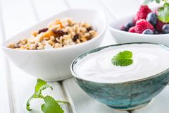 Muesli yoghurt and berries. Healthy breakfast with yogurt granola and fresh fruit.  royalty free stock photography
