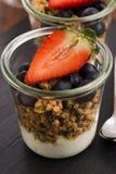 Muesli and yogurt with berries Royalty Free Stock Photo
