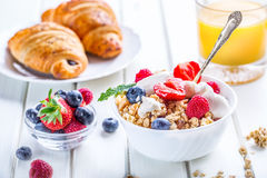 Muesli with yogurt and berries on a wooden table. Healthy fruit and cereal brakfast Stock Images