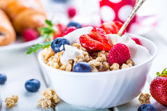 Muesli with yogurt and berries on a wooden table. Healthy fruit and cereal brakfast Royalty Free Stock Photo