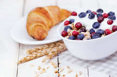 Muesli with yogurt and berry with tasty croissant Stock Image