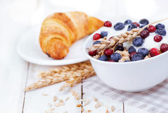 Muesli with yogurt and berry with tasty croissant Royalty Free Stock Photography