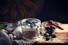 Muesli with yogurt and blue berries in glass jar. Stock Images