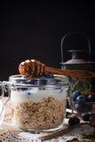 Muesli with yogurt and blue berries in glass jar. Stock Photo