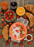Muesli with yogurt, croissant and fresh strawberries Royalty Free Stock Photo