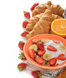 Muesli with yogurt, croissant and fresh strawberries Stock Image