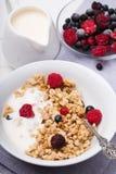 Muesli with yogurt and fresh berries in a ceramic bowl. Healthy breakfast. Granola, muesli with yogurt and fresh berries in a ceramic bowl Stock Photos