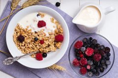 Muesli with yogurt and fresh berries in a ceramic bowl. Top view Royalty Free Stock Images