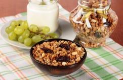 Muesli, yogurt and grapes Stock Photo