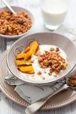 Muesli,yogurt and grilled peaches Stock Image