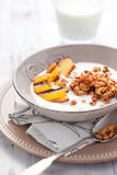 Muesli,yogurt and grilled peaches Stock Photography