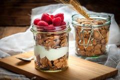 Muesli with yogurt and raspberries. Stock Photo