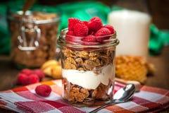 Muesli with yogurt and raspberries. Stock Image