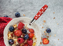 Muesly with berries. Muesly with blueberry, strawberry, raspberry and with milk in a bowl, healthy breakfast with cereals Royalty Free Stock Photography