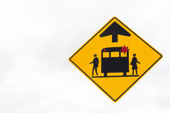 Muestra amarilla de la parada de la advertencia del autobús escolar del triángulo Fotografía de archivo