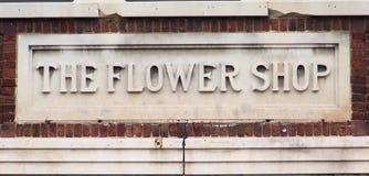 Muestra antigua de la floristería fotografía de archivo