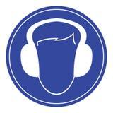 Muestra azul de las protecciones auditivas del desgaste imagen de archivo