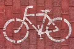 Muestra blanca de la bici en el camino de la bicicleta Imagenes de archivo