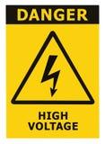Muestra de alto voltaje del peligro con el texto aislado Imagen de archivo libre de regalías
