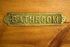 Muestra de bronce del cuarto de baño imagenes de archivo