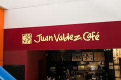 Muestra de la cafetería de Juan Valdez Café Café colombiano, negocio tradicional foto de archivo