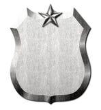 Muestra de la estrella del escudo del metal Imagen de archivo libre de regalías