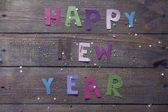 Muestra de la Feliz Año Nuevo de letras coloreadas Foto de archivo