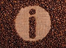 Muestra de la información hecha de los granos de café Foto de archivo