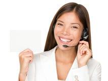 Muestra de la mujer del receptor de cabeza del centro de atención telefónica Imagen de archivo libre de regalías