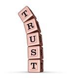 Muestra de la palabra de la confianza Pila que cae de Rose Gold Metallic Toy Blocks Fotografía de archivo
