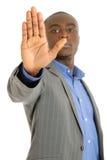 Muestra de la parada de la mano del hombre de negocios Foto de archivo