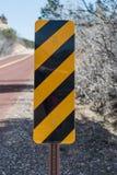 Muestra de la precaución en el lado del camino Imagen de archivo libre de regalías