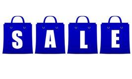 Muestra de la venta bajo la forma de bolsos azules con el lett blanco Fotografía de archivo libre de regalías