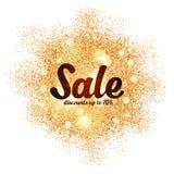 Muestra de la venta en chapoteo de oro del brillo en el blanco Foto de archivo