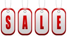 Muestra de la venta en la forma de una insignia roja con los agujeros p Foto de archivo libre de regalías