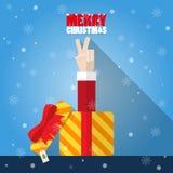 Muestra de la victoria de la mano de Santa Claus de la caja de regalo Imagen de archivo libre de regalías