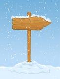 Muestra de madera con nieve que cae Fotos de archivo libres de regalías