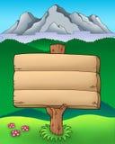 Muestra de madera grande con las montañas Imagenes de archivo