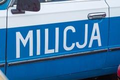 Muestra de Milicja en el coche Milicja es viejo nombre para la policía en Polonia Fotos de archivo libres de regalías