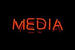 Muestra de neón de los media imagen de archivo libre de regalías