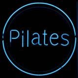 Muestra de neón de Pilates Imagen de archivo