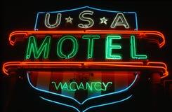 Muestra de neón del motel imagenes de archivo