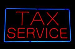 Muestra de neón roja del servicio del impuesto Foto de archivo