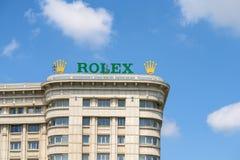Muestra de Rolex Company en el edificio Foto de archivo libre de regalías