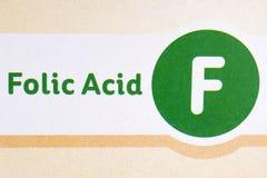 Muestra del ácido fólico en el acondicionamiento de los alimentos imagen de archivo libre de regalías