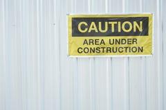 muestra del área de la construcción de la precaución en la pared Fotos de archivo